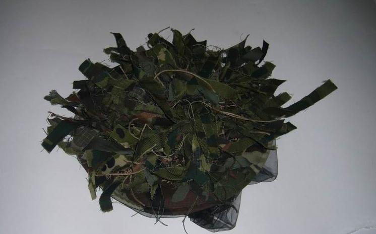 При улучшение маскировочных свойств обычного накомарника был использован ку